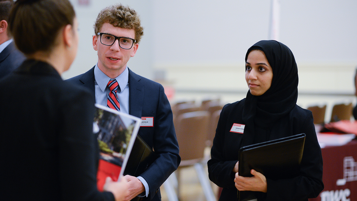 Students talk with prospective employers on NCState's campus