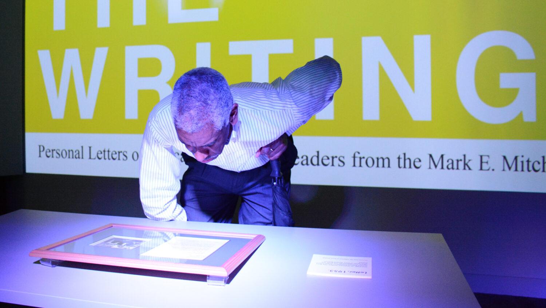 man looking at history exhibit