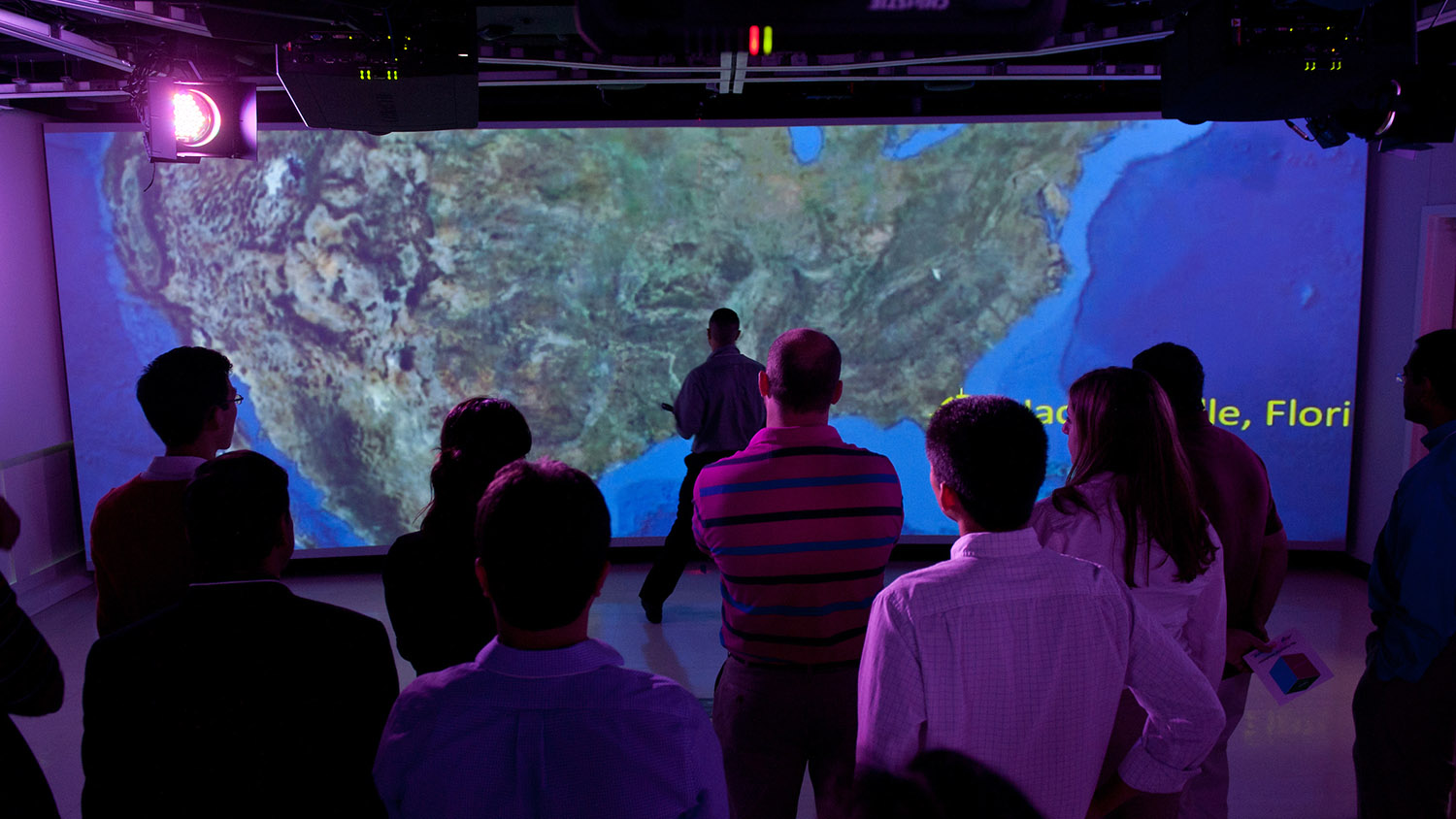 students looking at screen with map of U.S.