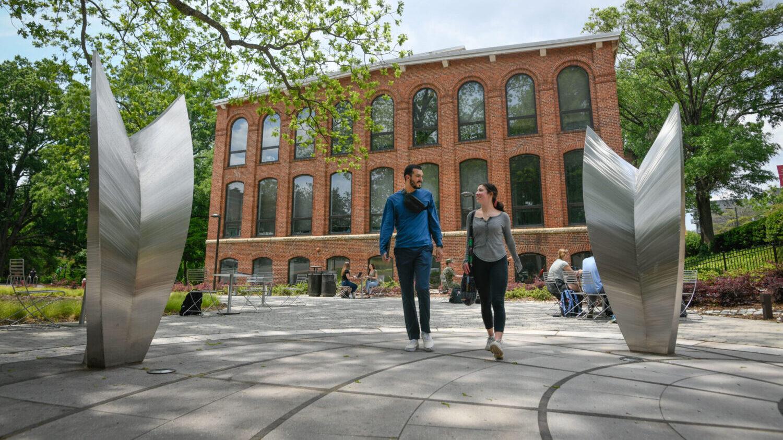 Students walk across the Global Courtyard